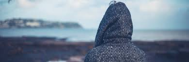 Image of person looking out to sea
