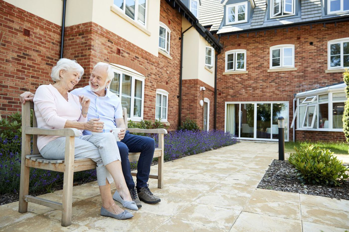Image of ageing couple outside a Nursing Home