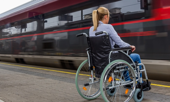 Image of wheelchair user at train station